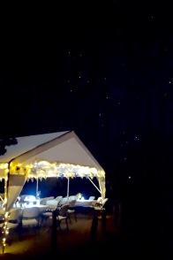 NeoRio Main Tent still glowing beneath the Night Sky
