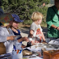 Young participants exploring the SEED Sensorium with Katie Woodall, of SEED Taos